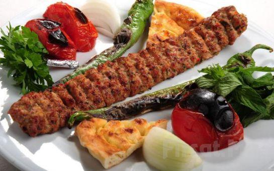 Koşuyolu'nda Adana Lezz Et Kebap'tan Odun Ateşinde İskender veya Meze ve Yerli İçecek Dahil Kebap Menüleri