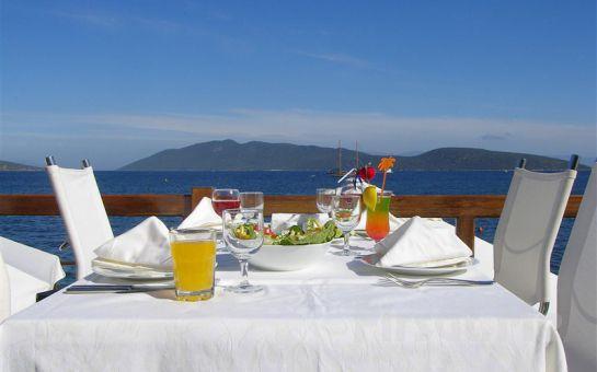 Bodrumun Maviliğinde Denize Sıfır Yaz Tatili Mavi Kumsal Otel'de Yarım Pansiyon Tatil Fırsatı